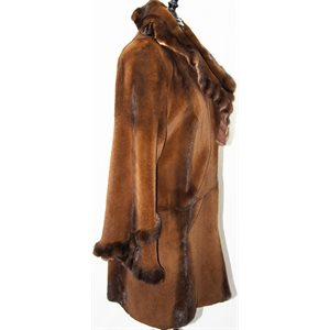 COGNAC DYED SHEARED MINK WITH LONG HAIR TRIM